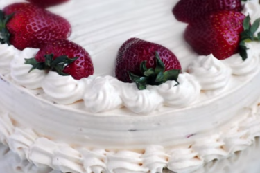 Tres Leches Cake With Arequipe Whipped Cream and Strawberries, photo by Sweet y Salado