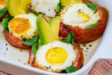Avocado-Baked Eggs in Roasted Tomatoes, photo by Fresh Avocados - Love One Today