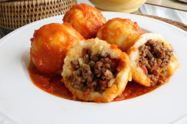 Bollos Pelones (Venezuelan Meatballs Wrapped in Arepa Dough), photo by Hispanic Kitchen