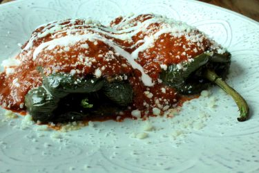 Chiles Rellenos with Queso Fresco and Chipotle Tomato Sauce, photo by Fernanda Alvarez