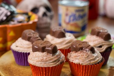 Spicy Mexican Chocolate Cupcakes topped with Nestlé Butterfinger Peanut Butter Cups Skulls, photo by Hispanic Kitchen